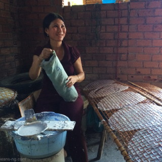 Local Vietnamese lady making rice paper