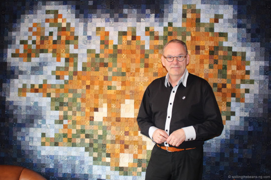 Mr. Ingi Þór Jakobssen standing in front of the Icelandic quilt
