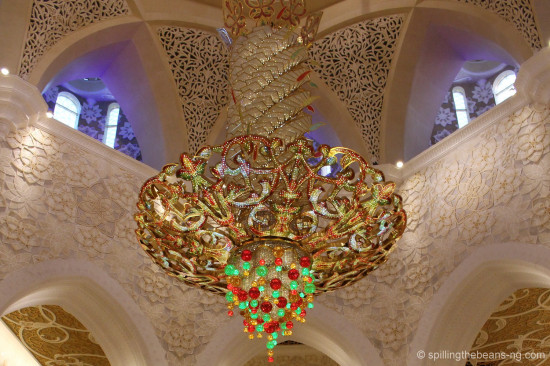 Colorful gold and crystal chandelier in the prayer hall